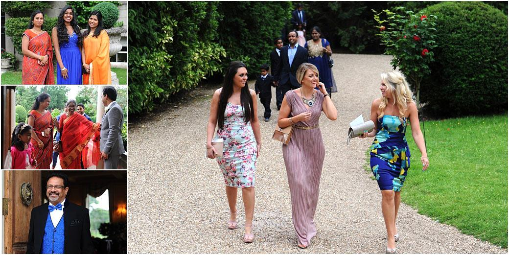 Smiling ladies in colourful saris and summer dresses arriving at Hampton Court House Surrey a truly wonderful hidden gem of a wedding venue
