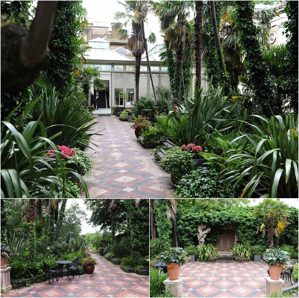 The exotic looking Winter Garden with palm trees and tiled floor at Surrey wedding venue Hampton Court House across from world famous Hampton Court Palace