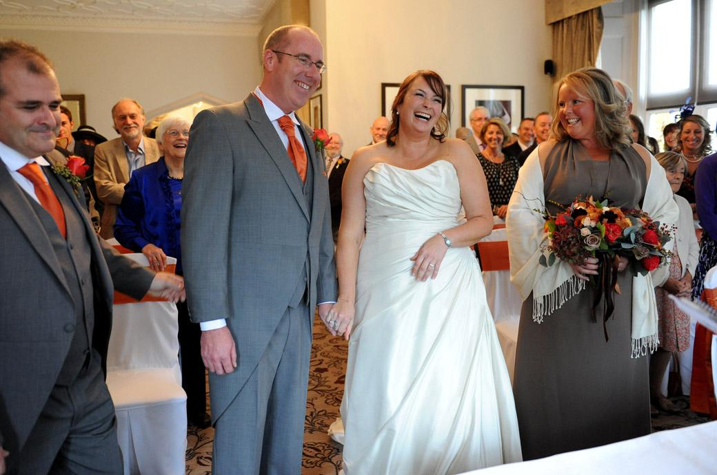 Plenty of laughter during this light hearted moment in a marriage ceremony at Surrey wedding venue Hartsfield Manor, Betchworth taken in the Terrace Room