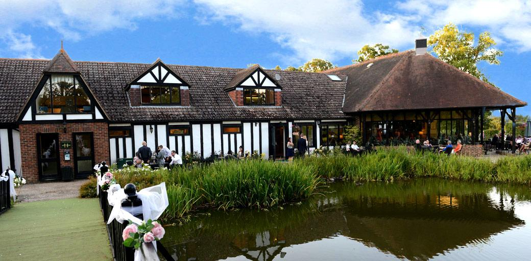 The picturesque and welcoming Kent wedding venue Hever Castle Golf Club complete with ornamental pond and bridge and part of the beautiful and historic Hever Castle estate