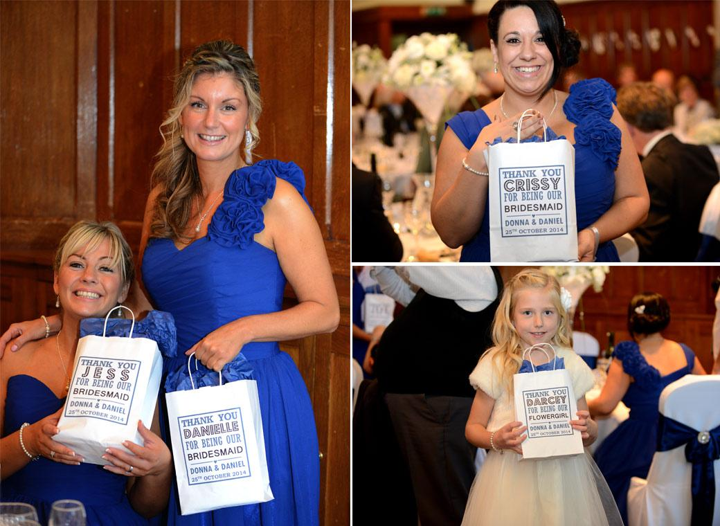 Smiling Bridesmaids captured in these wedding photos showing off their personalised gift bags during the speeches in the Horsley Towers