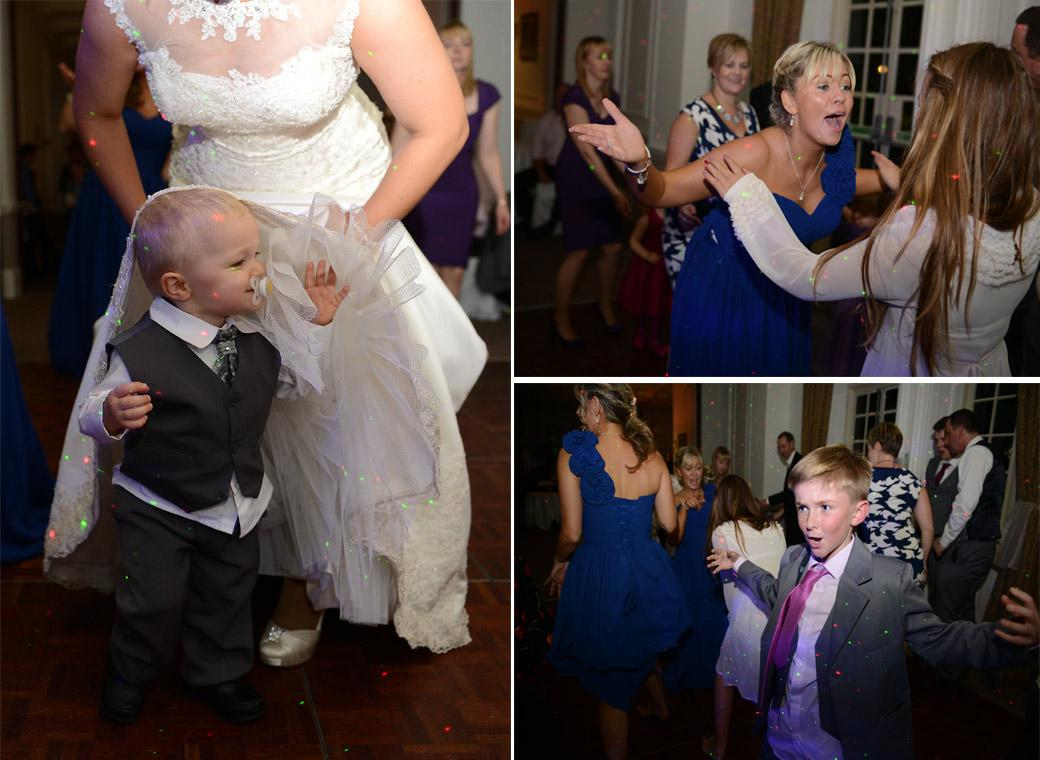 Dancing and having fun during the disco captured in these passionate wedding photographs taken at Surrey wedding venue Horsley Towers on the dance floor in the Sopwith Room