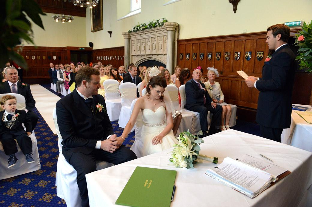Emotional moment for the Bride as her brother performs the reading in this personal wedding picture captured in the Great Hall of the Surrey wedding venue Horsley Towers