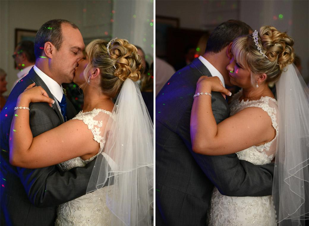 Bride and Groom romantically kiss and hug in these wedding photos as they perform their first dance in the Sopwith Room at Horsley Towers by Surrey Lane wedding photographers