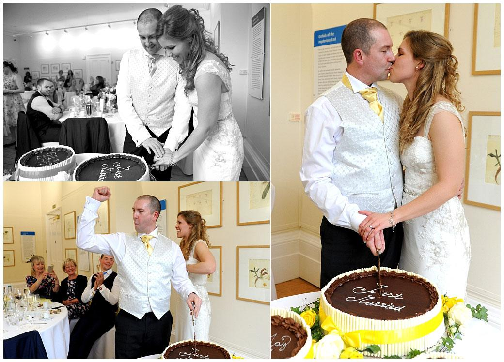 Romance and celebrations as the happy newlyweds cut their wedding cake in The Gallery at Surrey wedding venue Cambridge Cottage in Kew Gardens