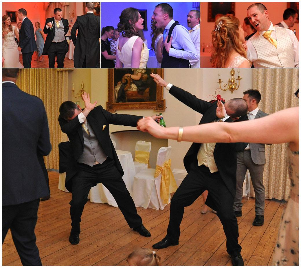 Bride and groom with their guests on the dance floor at Surrey wedding venue Cambridge Cottage Kew Gardens enjoying themselves as they make their dance moves