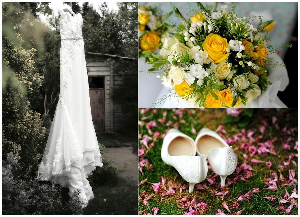 Wedding dress hanging in tree, shoes on petals on the grass and a bright bouquet ready for a marriage at Kew Gardens at Surrey wedding venue Cambridge Cottage