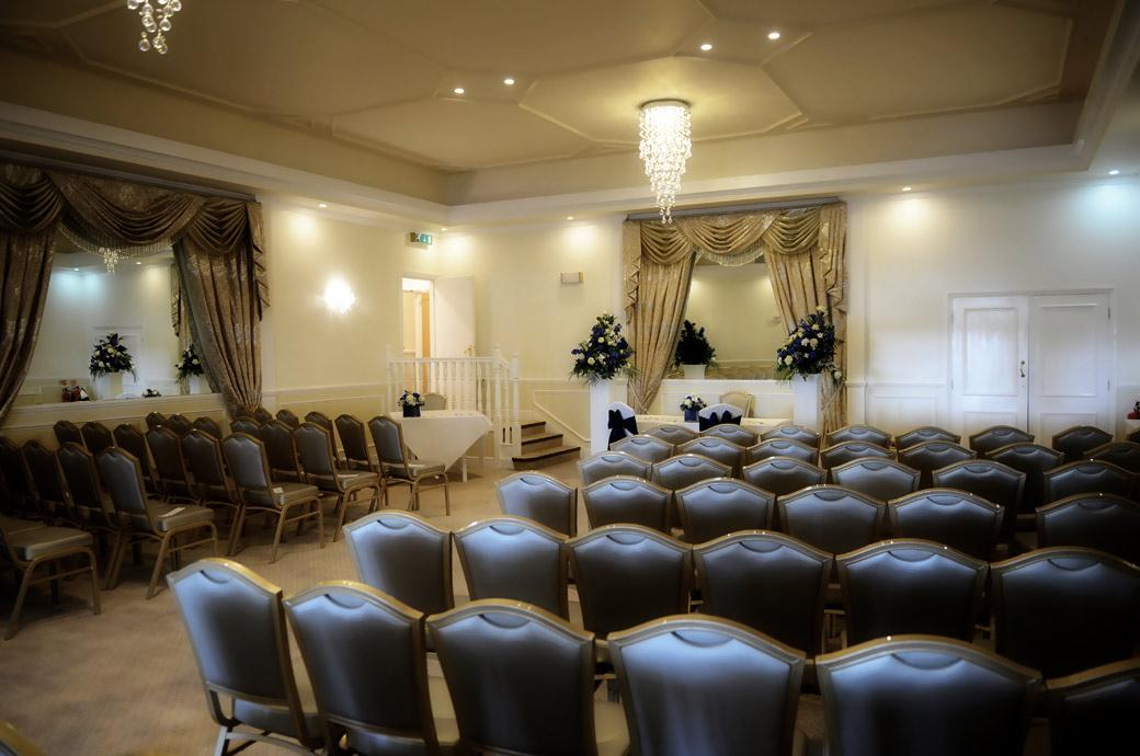 The Sumptuous wedding ceremony room dressed ready for the arrival of guests at Kingswood Golf Club a popular Surrey wedding venue with a relaxed and friendly atmosphere