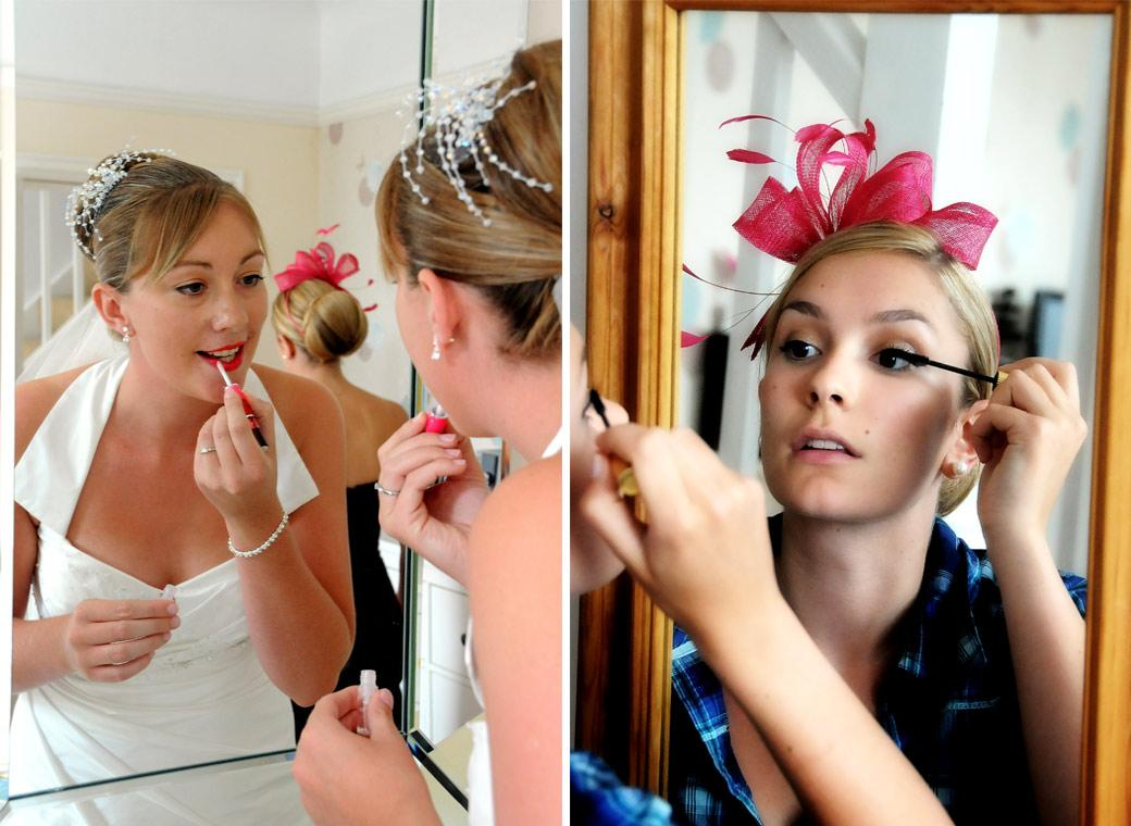 Colourful wedding photos of a Bride and her Bridesmaid looking into a mirror and applying makeup before leaving for a wedding at Kingswood Golf Club in Surrey
