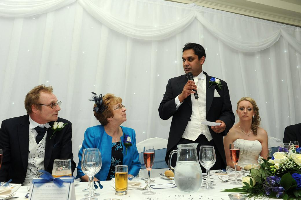 The Groom saying some lovely words about the bride's parents in this wedding picture taken during the speeches at the Surrey venue Kingswood Golf Club in the Conservatory