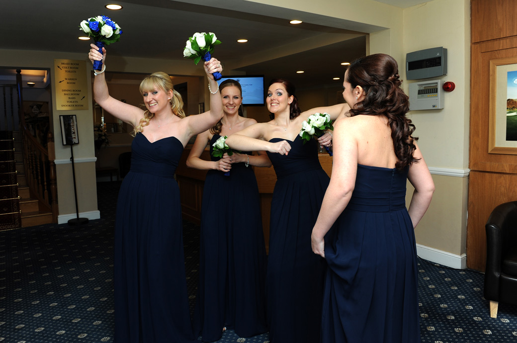 Bridesmaids playing around in this fun wedding picture taken as they wait for the Bride to finish her interview at Surrey wedding venue Kingswood Golf Club