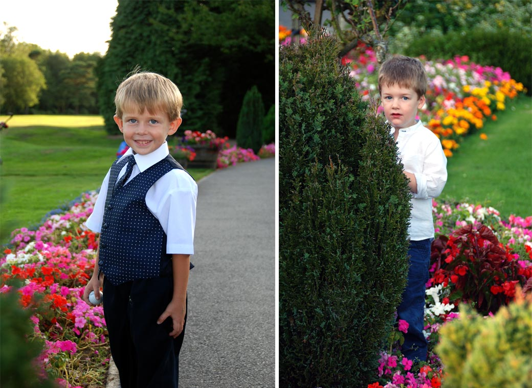 Couple of mischievous young boy wedding photos one holding a golf ball the other in the flowers at Surrey wedding venue Kingswood Golf Club in Tadworth