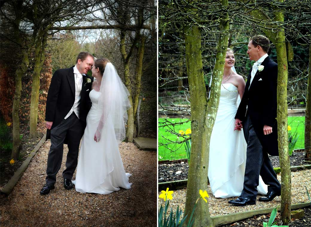 Two romantic Bride and Groom wedding photographs taken as they walk in the lovely gardens at the 16th Century Surrey wedding venue Langshot Manor