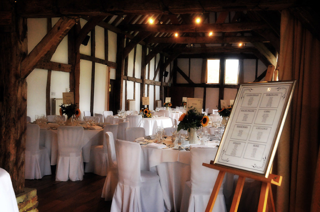 A calm peaceful and empty Tithe Barn wedding photo taken before guests have arrived for the wedding breakfast at Loseley Park Guildford by Surrey Lane wedding photography