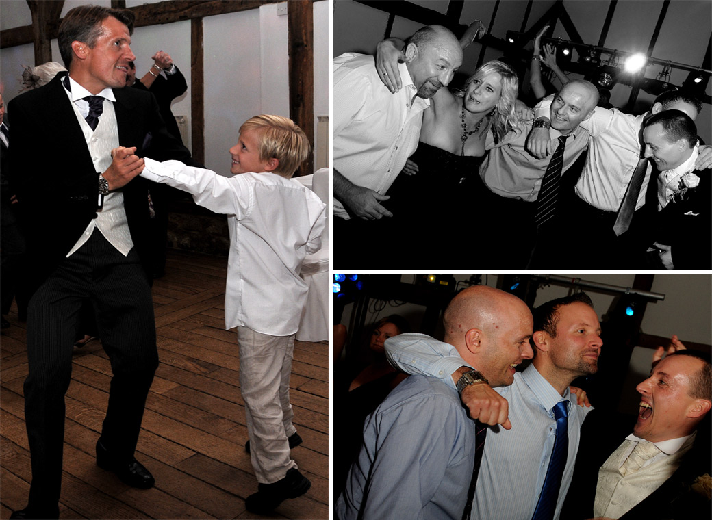 Wedding guests having a good time on the dance floor in these fun wedding pictures captured at Surrey wedding venue Loseley Park in the 17th Century Tithe Barn