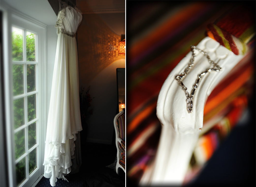 Wedding photos of the Bride's dress hanging by the door and her bracelet on the arm of a chair taken in the Tennyson Room at Lythe Hill Hotel Haslemere Surrey