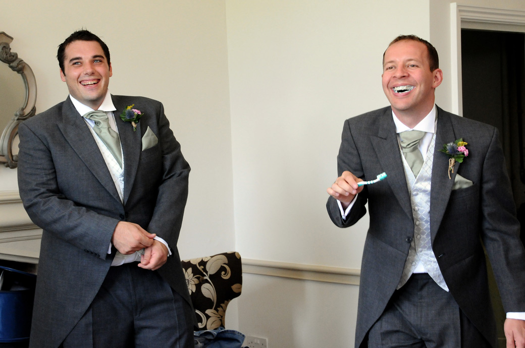 Laughter as a Groomsman remembers at the last minute to wash his teeth captured in this Nonsuch Mansion wedding picture taken in Cheam Surrey
