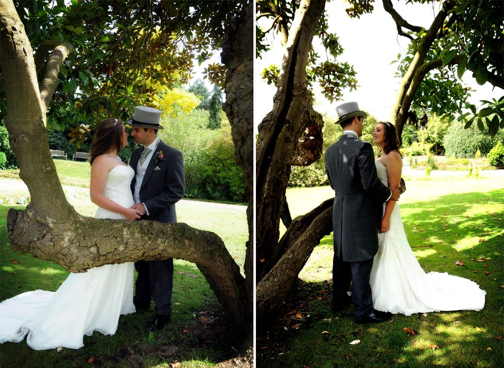 Newly-weds standing romantically together by a tree in this wedding photograph taken at Surrey wedding venue Nonsuch Mansion in Cheam