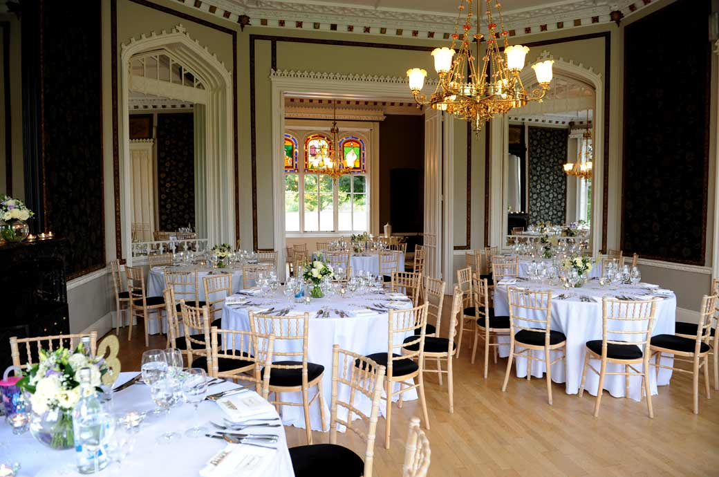 The Tulip Room set up for the wedding breakfast and awaiting the arrival of the guests at Nonsuch Mansion a wedding venue in Cheam Surrey