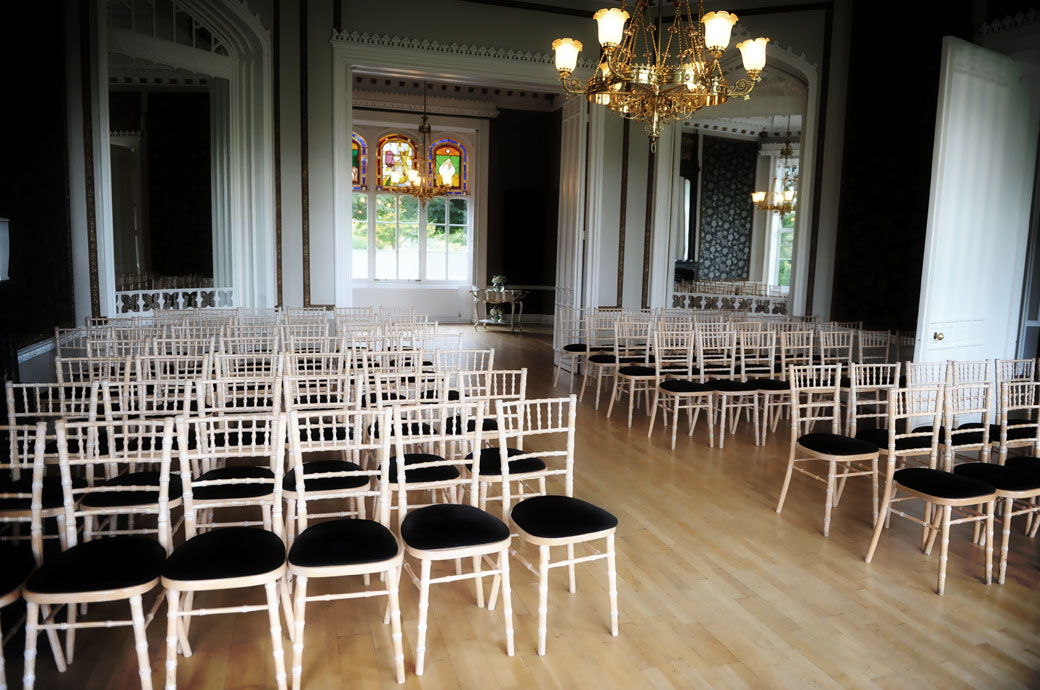 The empty chairs of the Orchid Room awaiting the arrival of the guests captured in this wedding photograph taken at Surrey wedding venue  Nonsuch Mansion