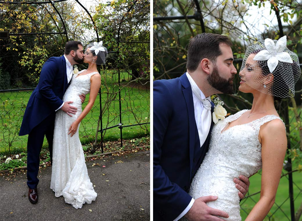 Two wedding pictures of the Bride and Groom getting together and having a romantic kiss in Surrey at Nonsuch Mansion in the celebrated Rose Walk
