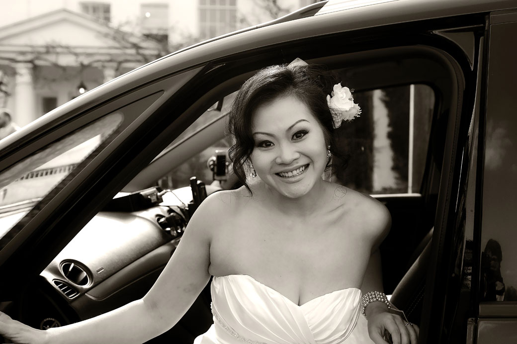 Beautiful smiling Bride captured in this wedding photo as she gets out of the bridal car for her marriage at the lovely Surrey wedding venue Pembroke Lodge