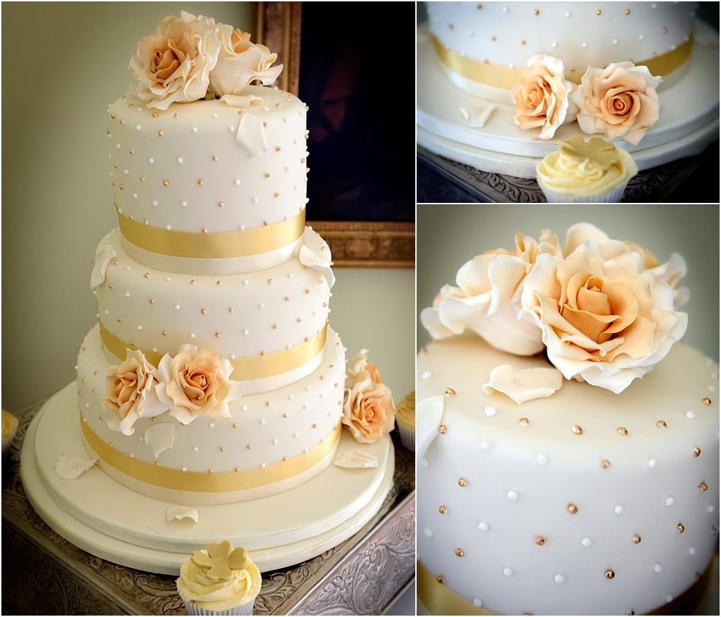 Beautiful gold and white decorated three tier wedding cake captured by Surrey Lane wedding photography at Pembroke Lodge in the Belvedere Suite