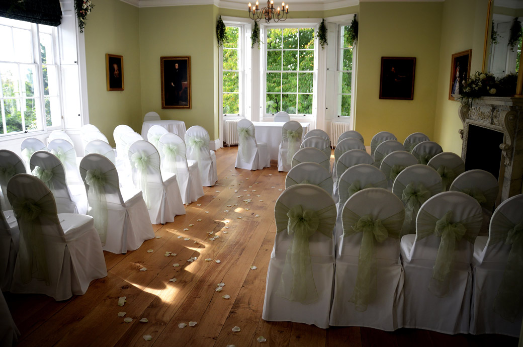 An empty Russell Suite ready with petals on the floor for guests to arrive in this wedding picture taken at Pembroke Lodge Richmond a lovely Surrey wedding venue