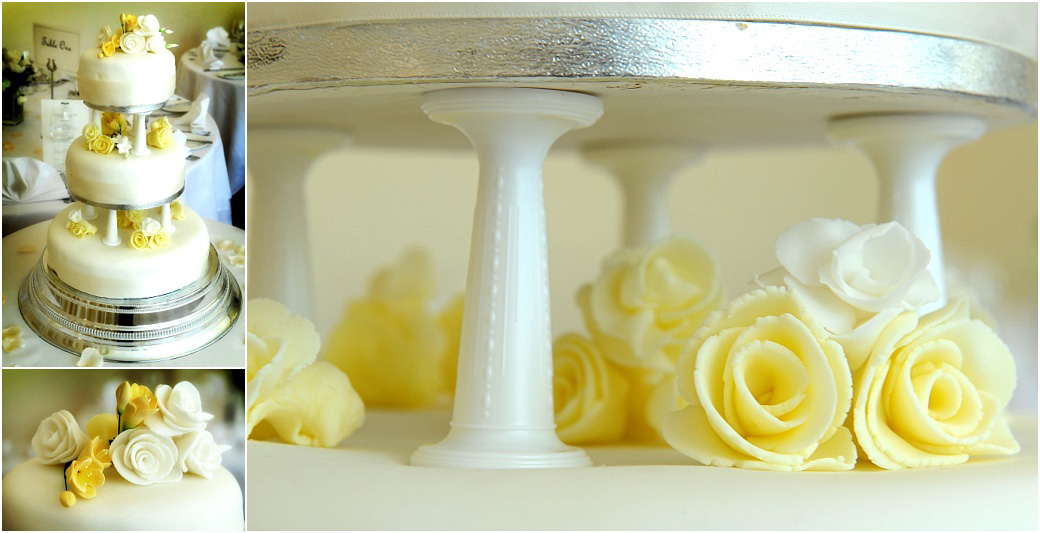 A picture from Surrey wedding venue Pembroke Lodge in Richmond Park of a lovely fresh and light looking wedding cake decorated with white and yellow icing flowers