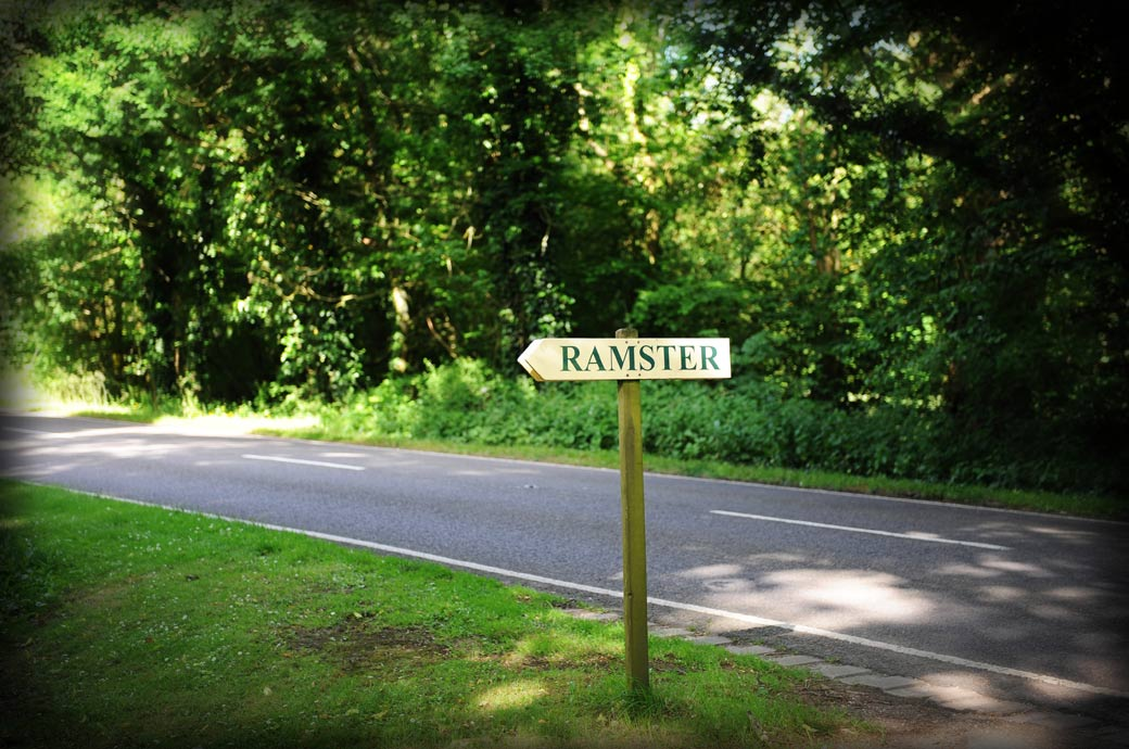 A simple wooden Ramster road sign captured in this wedding photo by a Surrey Lane wedding photographer arriving at Ramster Hall in Chiddingfold, Guildford