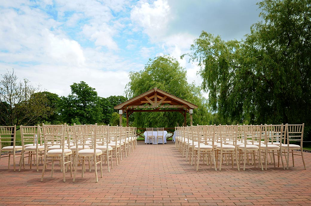 The rows of chairs set ready for the arrival of guests at the popular outdoor Waterside venue at Surrey wedding venue Reigate Hill Golf Club