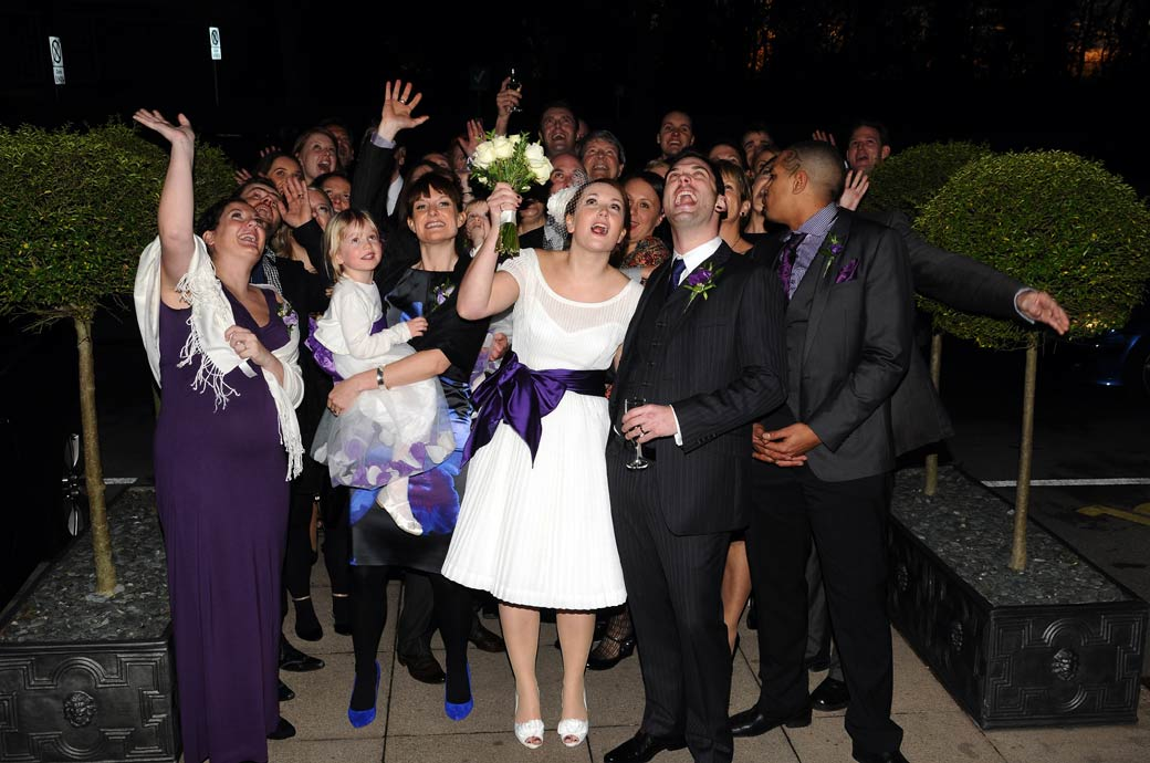 A fun photo of everyone at the Richmond Gate Hotel wedding laughing and waving at the wedding photographer up above