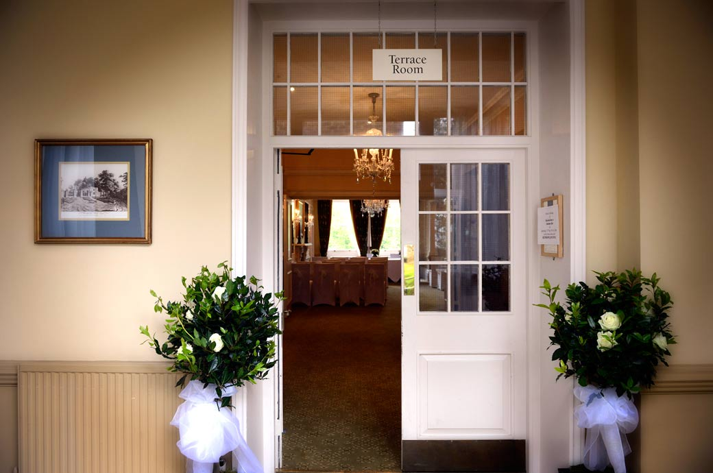 A picture of an open door into the Terrace Room, the main ceremony room at Richmond Gate Hotel Surrey wedding venue