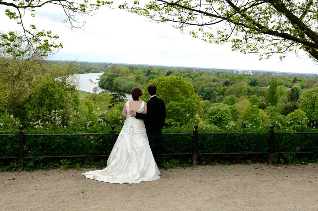 Romantic photo of couple wedding couple taking in the fabulous view from over the road from the Richmond Gate Hotel Surrey wedding venue