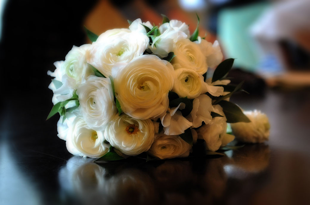 A lovely soft focus dreamy bouquet wedding photo take on the ceremony table at Richmond Register Office Surrey