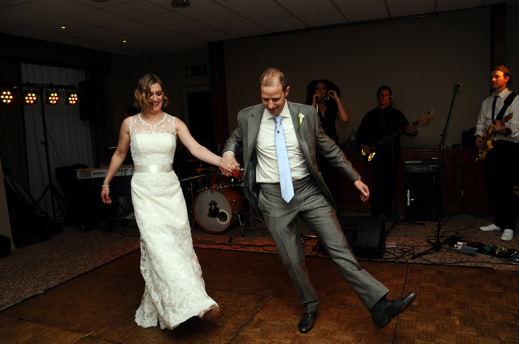 Bride and Groom go through their funny routine for their hilarious first dance at the popular Surrey wedding venue Selsdon Park Hotel during in this great wedding picture