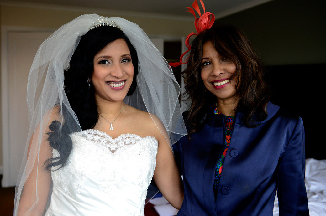 All smiles for a beautiful mother and Bride captured in this wedding picture taken as they are set ready for the marriage at the Selsdon Park Hotel in Croydon Surrey
