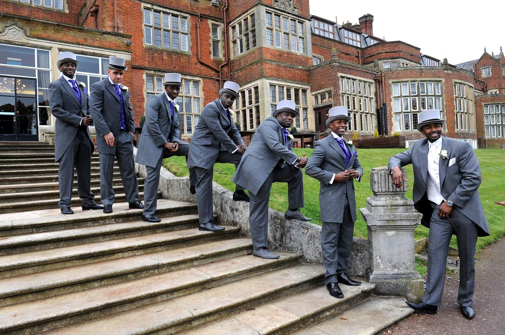 The Handsome Groom and his good looking Best men all strike a pose on the steps leading up to Selsdon Park Hotel in this relaxed and fun Surrey wedding picture