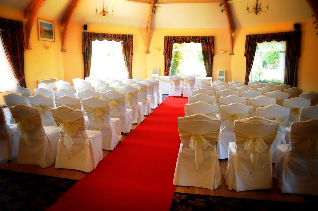An inviting marriage ceremony room wedding picture awaiting the guests at the Surrey wedding venue of Shirley Park Golf Club Croydon
