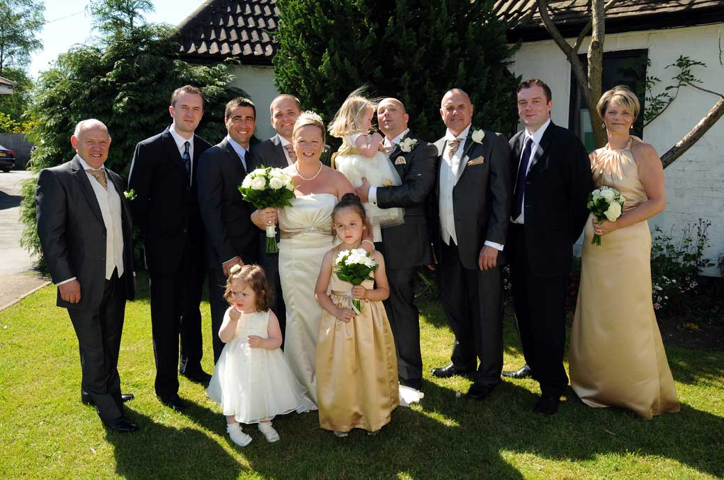 Family group wedding photograph taken on a bright summer's day by Surrey Lane wedding photographers at Croydon venue Shirley Park Golf Club