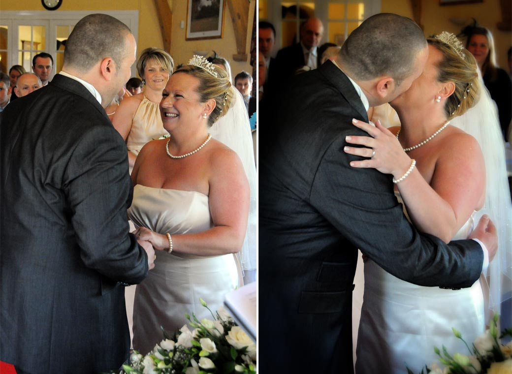 Wedding couple happily embrace and kiss as they complete their marriage at a Surrey wedding in Shirley Park Golf Club Croydon