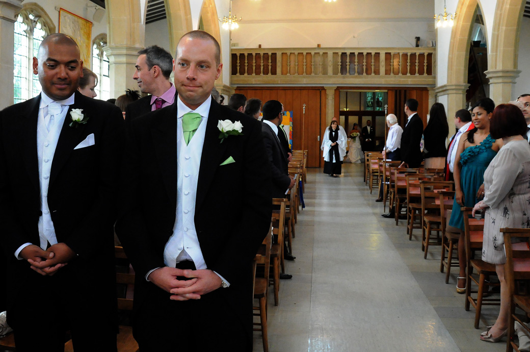 An anxious Groom awaits his Bride wedding photograph captured at St. John the Evangelist Church, Old Coulsdon by Surrey Lane wedding photographers