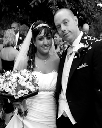 Happy and relaxed Bride and Groom wedding photograph taken at the ancient Grade 1 listed eleventh century Surrey wedding venue St. John the Evangelist Church Old Coulsdon