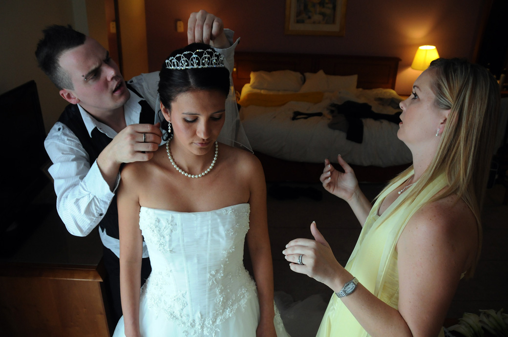 A serene Bride having her veil adjusted wedding photograph captured at the Croydon Hilton Hotel prior to arriving at St Mary's Church Beddington Surrey