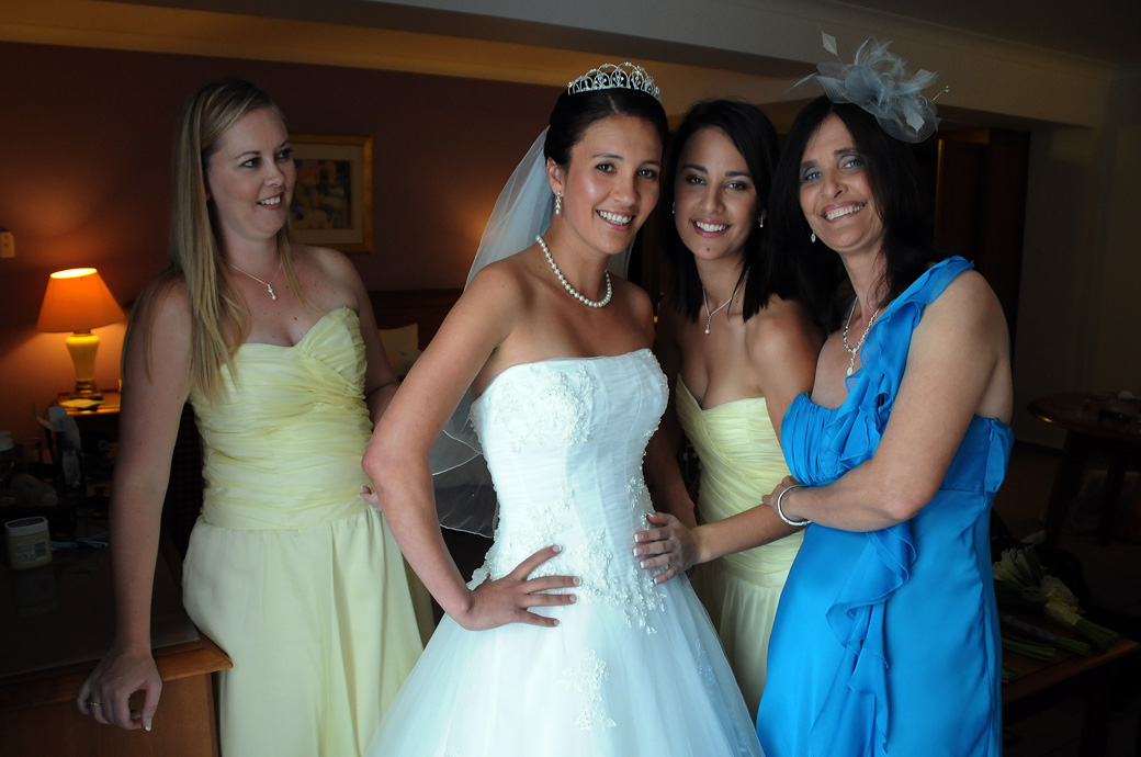 Happy Bride Bridesmaids and Mother wedding photograph captured at the Croydon Hilton Hotel prior to arriving at St Mary's Church Beddington Surrey