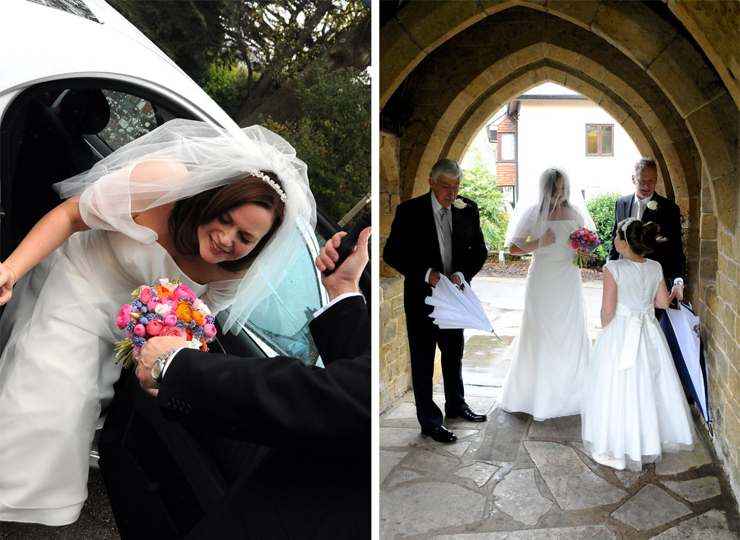 Bride arriving at the church in the rain wedding pictures captured at St Nicolas Church Cranleigh by Surrey Lane wedding photography