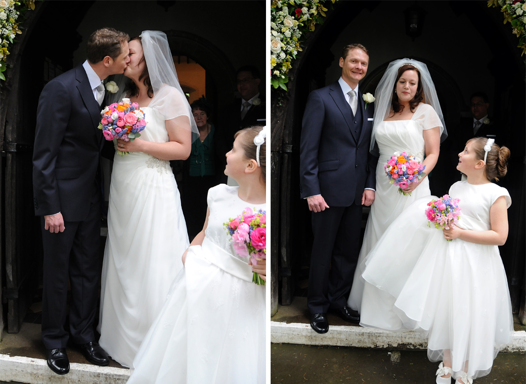 All in white with colourful flowers and a kiss wedding photos taken at St Nicolas Cranleigh a picturesque and medieval Surrey wedding venue