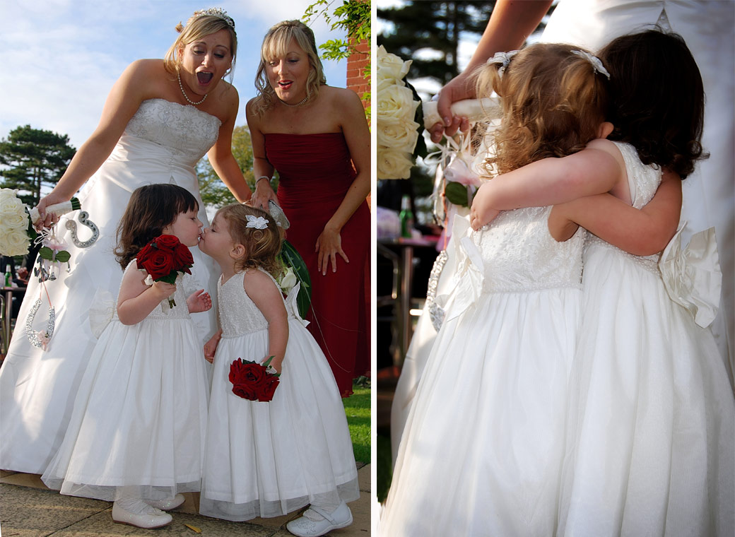 Cute little Bridesmaids have a kiss and a hug in these delightful wedding photographs taken at Stanhill Court Hotel a lovely Surrey wedding venue in Horley