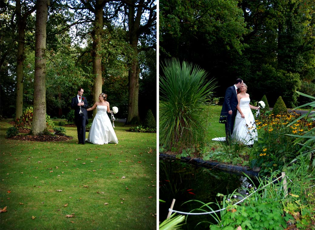Romantic wedding photographs of the Bride and Groom walking past the water feature and under the trees at Surrey wedding venue Stanhill Court Hotel