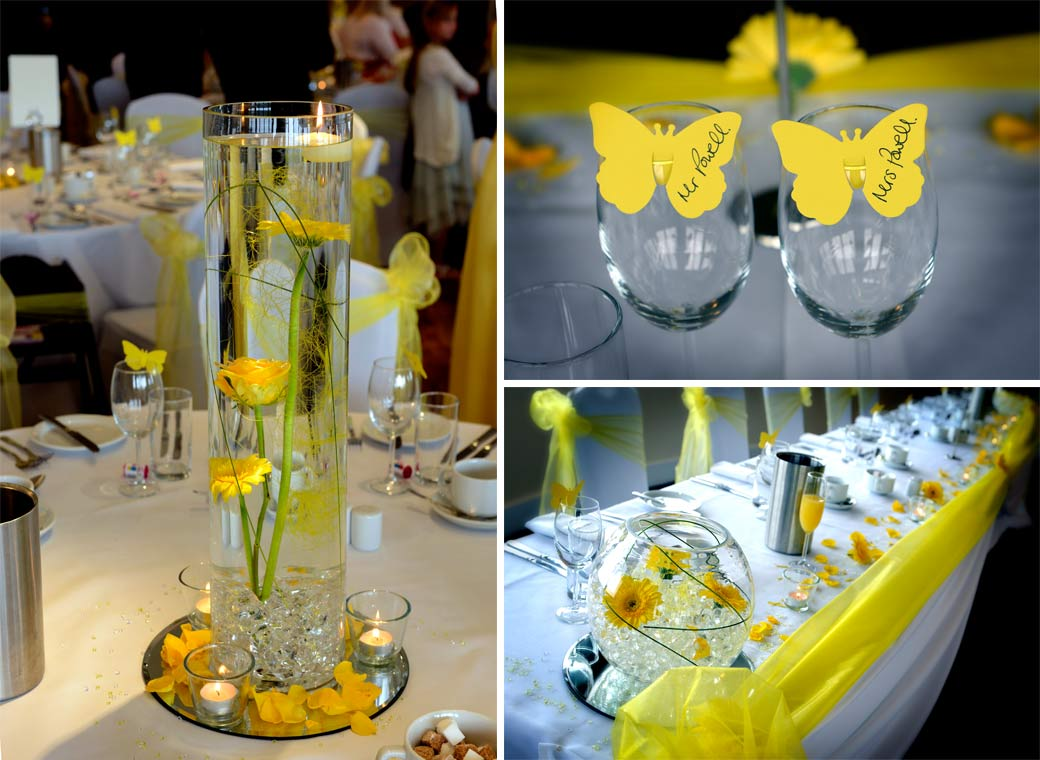 Yellow petals, flowers, ribbons and butterfly top table settings wedding photograph taken in the Willow Suite at Surrey Downs Golf Club by Surrey Lane wedding photographers
